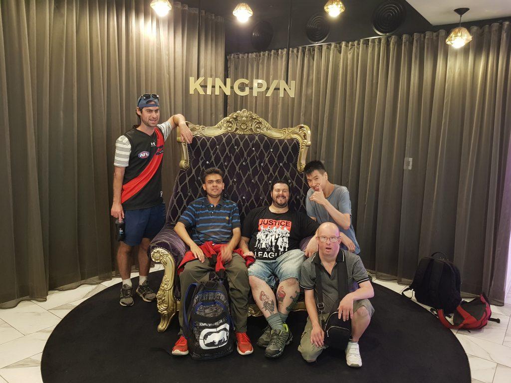 Participants at King Pin bowling, on big chair