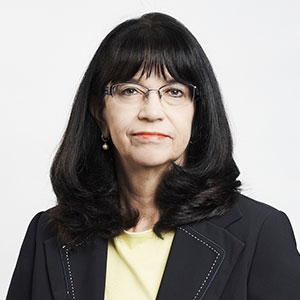 Linda Bennet, board member, black hair, fringe, glasses