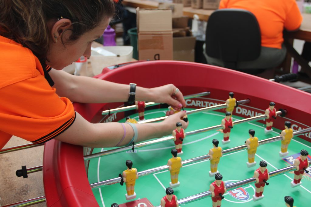 Person with a disability Assembling football table