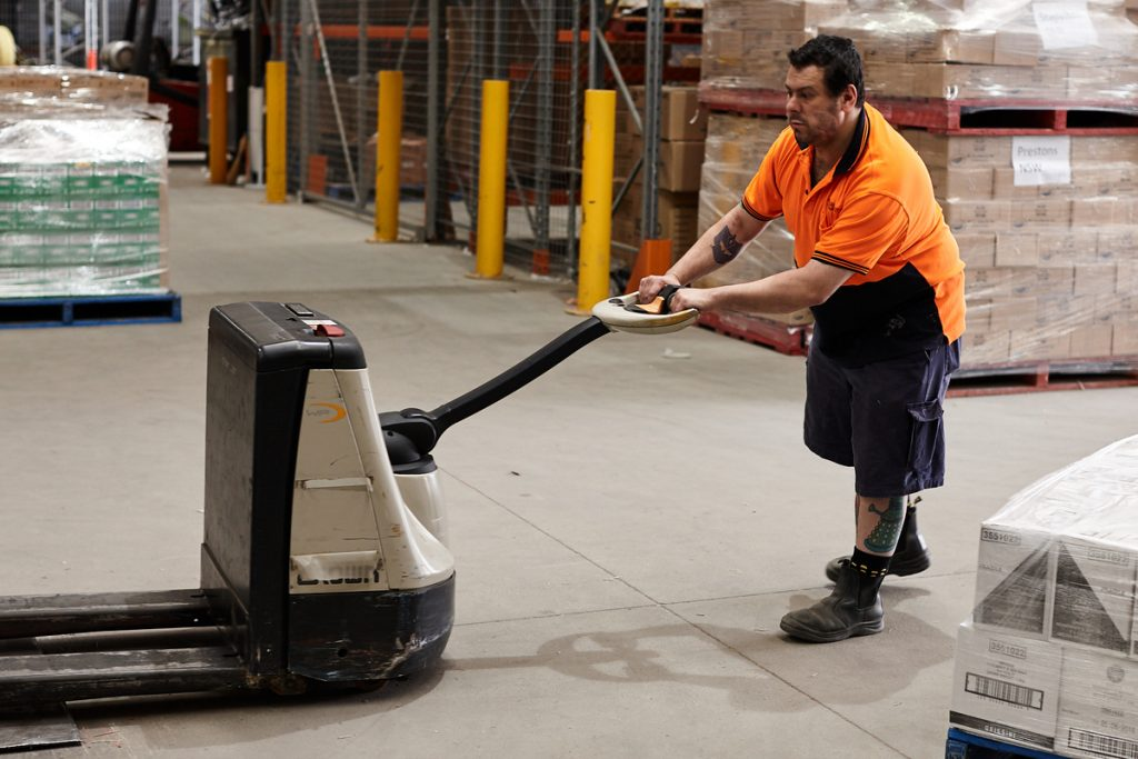Person with a disability pushing a pallet